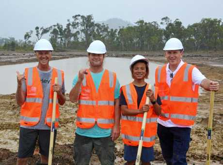 Barton Lynch, Mark Occhilupo and his son Jay join surf Lakes CEO Aaron Trevis on a recent site inspection of works underway at the demo site on the Capricorn Coast.