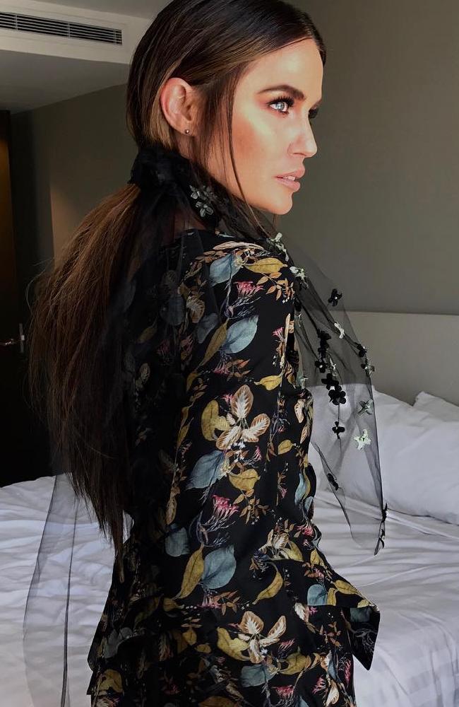 Jodi Anasta went against pastels, instead wearing a dark dress by Australia designer Nicholas.
