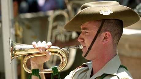 Bugle player Curtis Wilcox from the Army Band plays The Last Post. Picture: Mark Calleja
