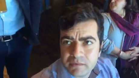 Sam Dastyari copped racist taunts in a Melbourne Pub in a video posted to Facebook by the far right group 'Patriot Blue'. (Pic: Facebook.)