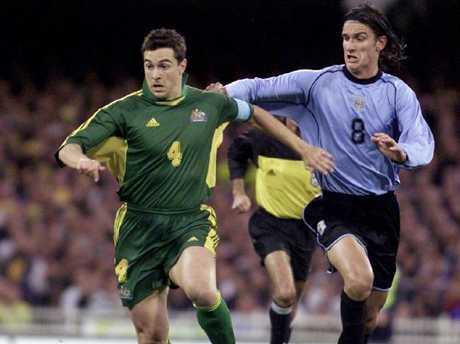 Paul Okon and Uruguay's Gonzalas De Los Santos in 2001.
