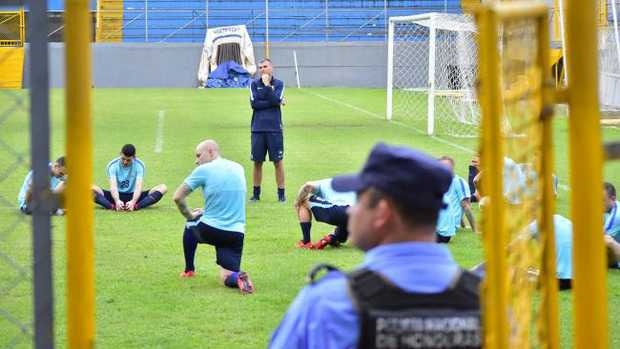 A policeman stands guard as the Socceroos train.