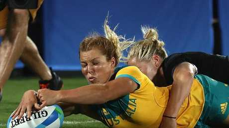 Emma Tonegato of Australia scores a try in the 2016 Rio Olympics gold medal match.