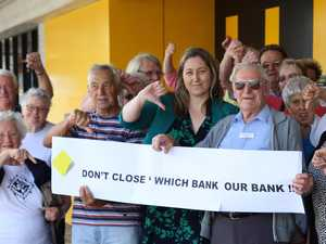 WHICH BANK … IS NEXT?: Member for Dobell, Emma McBride, joins members of the Toukley Senior Citizens at the Commonwealth Bank recently to sign their petition and support their campaign to save the local branch.