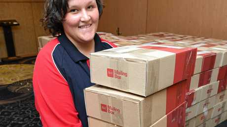 Care packages - Rachel Bishop with more packages ready to send.
