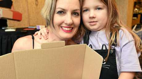 Ready to weigh-in their Christmas care package were Helen Skene and 5 yr old daughter Mia.