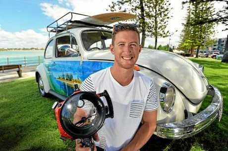 Photographer Karl Angell with his custom-painted VW Beetle.