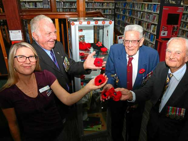 REMBERANCE DAY: Team leader of the Proserpine Library Robyn Batman with Proserpine RSL members Brian 'Weary' Dunlop, Ted Milne and George Gnezdiloff at the library on Friday.
