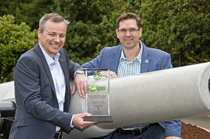 JUST REWARDS: The Chronicle's regional finance manager Patrick Wilson and Cr Geoff McDonald receive the AIH Rural Greenspace award.