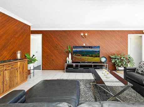 Timber finishes make the living room stand out in this huge home.