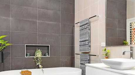 The bathroom has been fully renovated and boasts a trendy look for new owners.