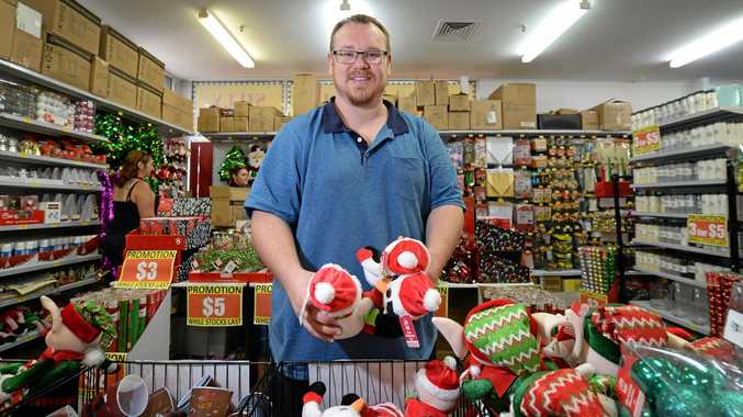 Brad Walton at the popup Silly Sollys store at Northside Plaza.