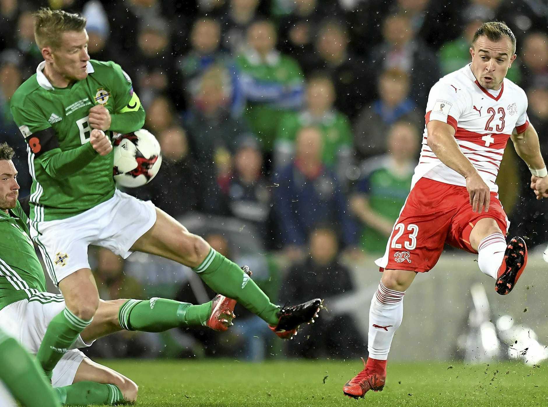 Northern Ireland midfielder Steven Davis (left) fights for the ball with Switzerland midfielder Xherdan Shaqiri.