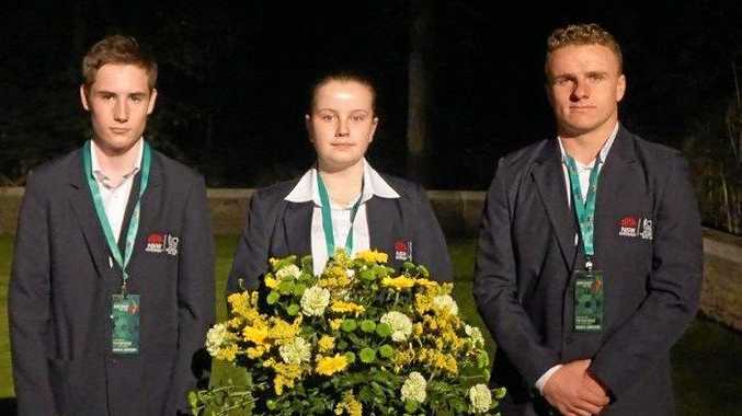 HONOUR: Tweed River High School's Rachel  Hudson   with fellow students  laying the wreath at the Polygon Wood dawn service as part of the Premier's Anzac Memorial   tour.