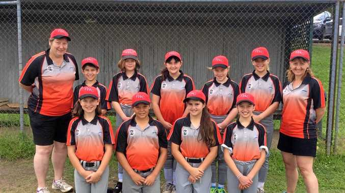 PHOTO: Assistant coach Christine Kane, left, and team manager Cheryl Nilon, right, with the Far North Coast Under-13 representative softball team to play in the state championship.