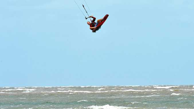 AIRBORNE: Kite surfer Alex Petrov makes the most of the high winds at Town Beach in Mackay.