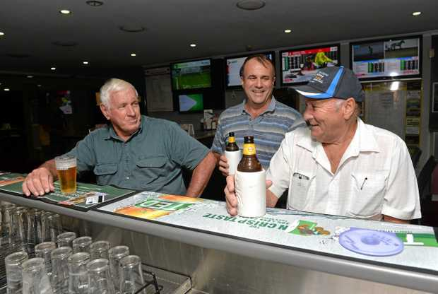 Grahame Tighe, Trevor Talbot and Marty Crane catch up for a chat at the Sarina Leagues Club.