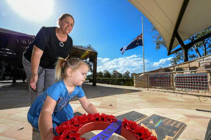 WE REMEMBER: Tilley Butler lays a wreath at the Remembrance Day memorial at Currumbin RSL with her aunty Kristy Smith.