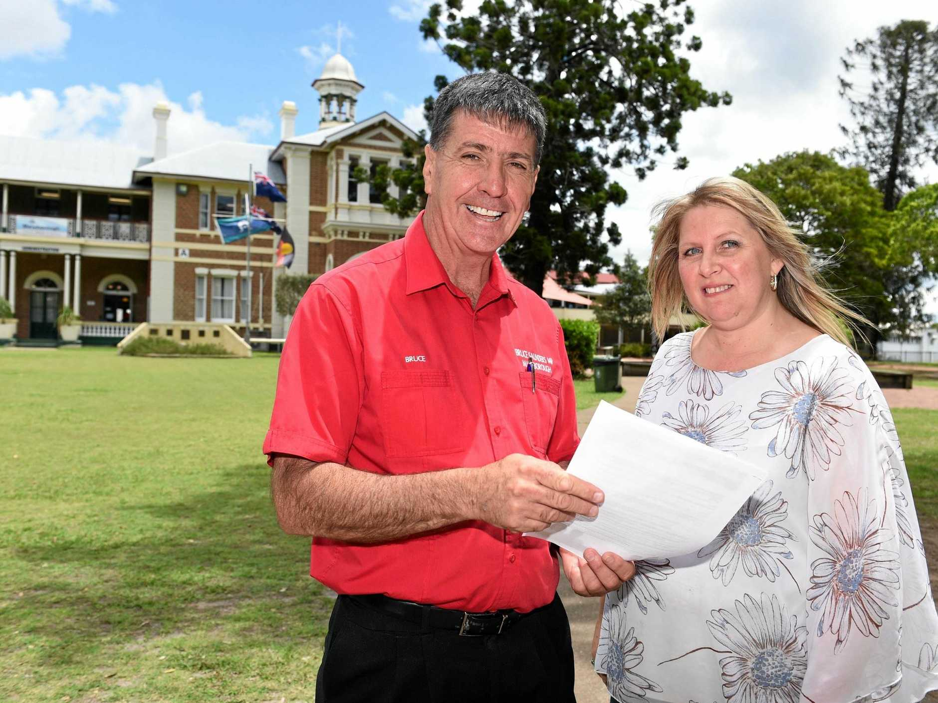 CHEQUE THIS: Labor Member for Maryborough Bruce Saunders makes a $10 million election pledge for Maryborough High School to Leeanne McIndoe, president of Maryborough High School P&C.