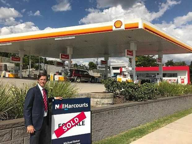 Michael Baker outside of the Shell service station on River Rd.