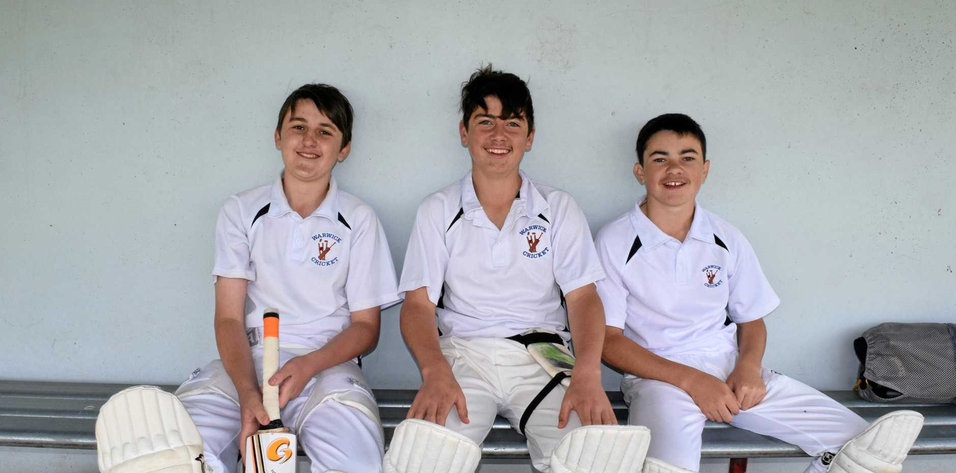 Lincoln Hay,  Joe Hume and Morgan Burke wait their turn to bat in the u16 game at Queens Park.