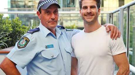Constable Arun Trevitt with Dan Price, whom he saved from a suicide attempt. Picture: Sam Ruttyn