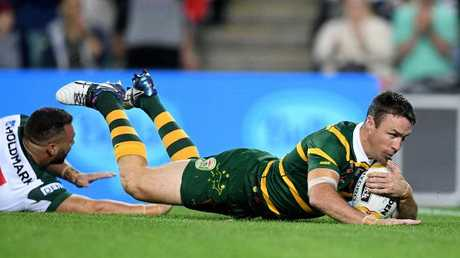 James Maloney crosses for a try.