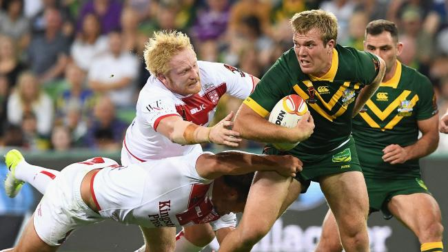 Jake Trbojevic of Australia is tackled during the 2017 Rugby League World Cup match between the Australian Kangaroos and England at AAMI Park.