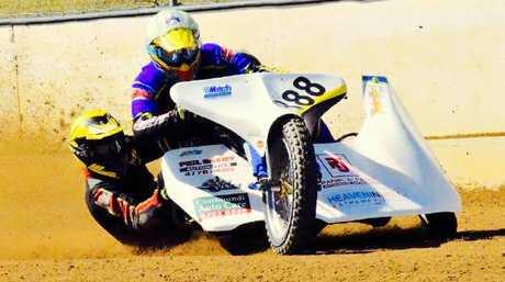 Sidecar racer.