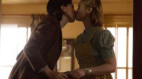 Bella Heathcote and Rebecca Hall steal a kiss in Professor Marston and the Wonder Women.