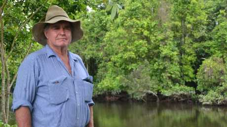 Chris Davy at the croc-infested lagoon, where he has lost numerous cattle and dogs. PICTURE: ELISABETH CHAMPION
