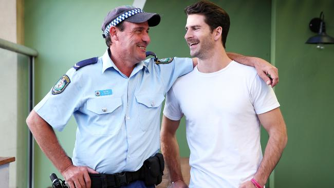 Police officer Arun Trevitt saved Dan Price's life after a suicide attempt three years ago and the pair have been mates since. Picture: Sam Ruttyn