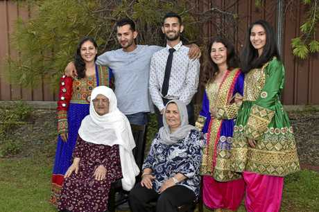 Celebrating family and food with the Aria family an Afghani family who arrived in Toowoomba 4 years ago as refugees, are a close and loving family who have embraced their new life. Back from left; Zahra, Ebrahim, Esmail, Zeynab, Fatima and front; their grandmother Zobeyden (left) and their mother Golmah. November 2017