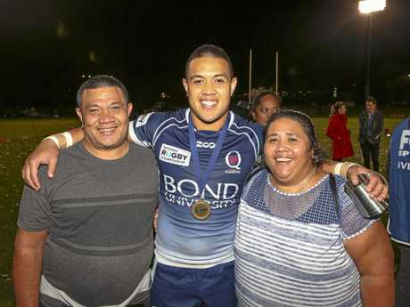 Duncan Paia'aua celebrates the win with his parents.