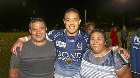 Duncan Paia'aua celebrates the win with his parents.