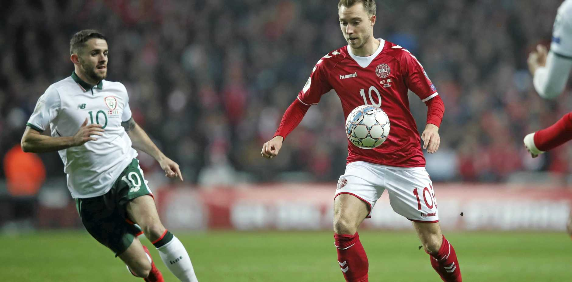Ireland's Robbie Brady and Denmark's Christian Eriksen, right, vie for the ball during the World Cup qualifying playoff first leg in Copenhagen.