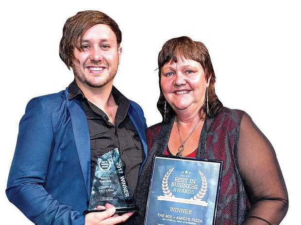 NORMANS THE CONQUERERS: Angela Norman and her son Brendan Norman  having taken home the 2017 trophy for overall Best in Business winner.