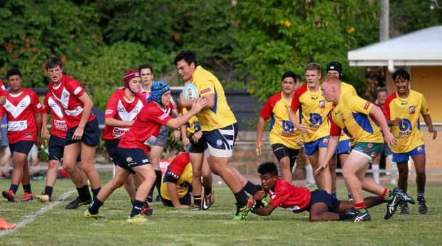 ON THE CHARGE: Gladstone winger Caleb Noovao makes some hard yards through the middle in the U15s clash against Brothers/Colts.