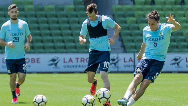 Socceroos stars (l-r) Mathew Leckie, Robbie Kruse and Mark Milligan train at AAMI Park ahead of Wednesday night's World Cup playoff second leg against Honduras.