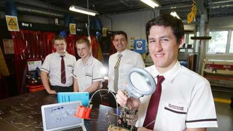 Glasshouse Christian College principal Mike Curtis (third from left) with Year 10 students Tyler Rees, Cody Jones and Casey Woods, who are  part of the DeLorean Project. Picture: AAP/Ric Frearson