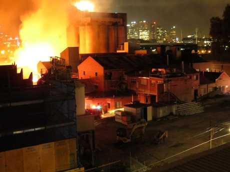 The fire was believed to be in an old factory site very close to the Nylex sign. Picture: Kiah Doodie