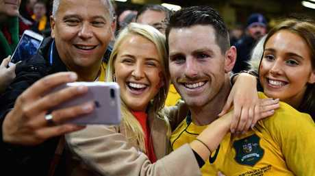 Bernard Foley mingles with the Aussie fans after the win in Cardiff.