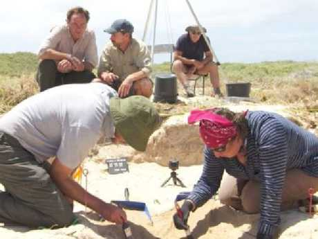 Archaeologists work to excavate the bones. Picture: 60 Minutes