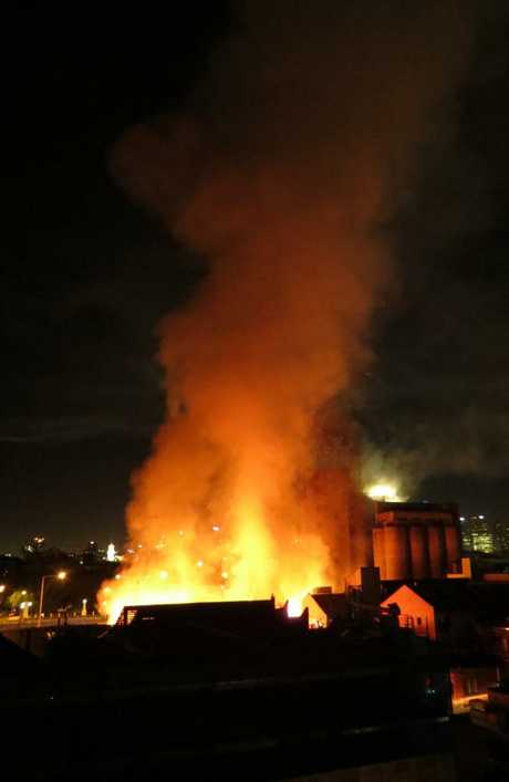 A photo showing a large fire in Cremorne early this morning which started close to the Nylex sign. Picture: Kiah Doodie