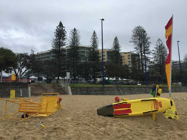 Life savers bunker down at Mooloolaba Beach due to weather conditions.