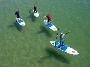 WRC drivers paddle board at Coffs Jetty
