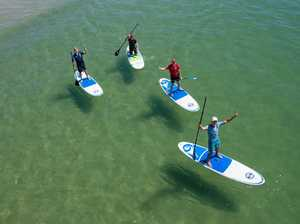 WRC drivers paddle board at Coffs Jetty
