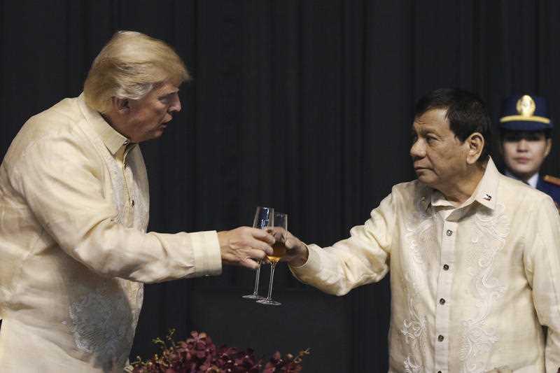 U.S. President Donald Trump toasts with Philippines President Rodrigo Duterte during the gala dinner marking ASEAN's 50th anniversary in Manila, Philippines, Sunday, Nov. 12, 2017.