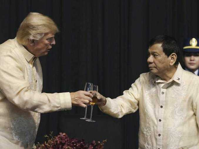 U.S. President Donald Trump toasts with Philippines President Rodrigo Duterte during the gala dinner marking ASEAN's 50th anniversary in Manila, Philippines, Sunday, Nov. 12, 2017.