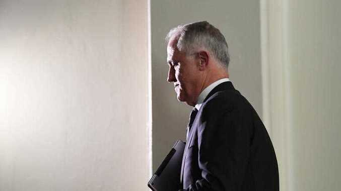 Prime Minister Malcolm Turnbull is seen exiting a press conference at the Commonwealth Parliamentary Offices in Melbourne on Wednesday, November 8, 2017.